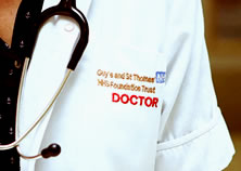 A doctor's coat and stethoscope